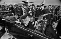 The motorcade leaving Dallas Love Field. Note the Pan Am 707 in background. (Sixth Floor Museum at Dealey Plaza)