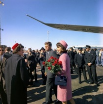 President and Mrs. Kennedy greeting well-wishers. Note the Pan Am 707 in background. (Cecil Stoughton photo)