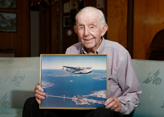 Gerry Mayhan, 99, holds a photograph of a Clipper airplane, circa 1939, at his home in Los Gatos, Calif., on Tuesday, Jan. 13, 2015. (Gary Reyes/Bay Area News Group)
